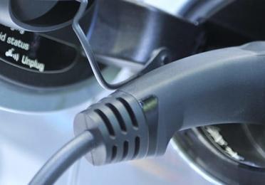 Electric vehicle charger plug