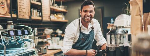 Smiling barista at the counter